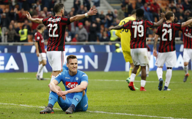Napoli's Arkadiusz Milik smiles after missing a scoring chance during the Serie A soccer match between AC Milan and Napoli at the San Siro stadium in Milan, Italy, Sunday, April 15, 2018. (AP Photo/Antonio Calanni)