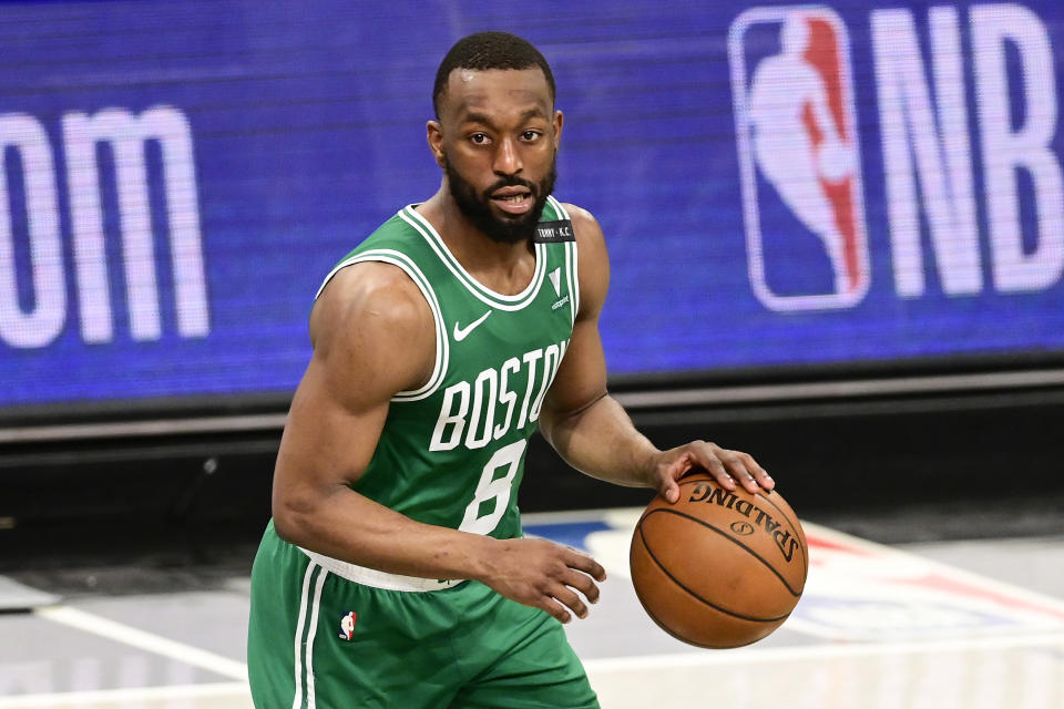 Kemba Walker dribbles the ball during a game.