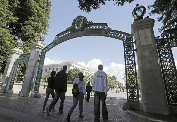 "A group of students walk through the Sather Gate at UC Berkeley. <span class=""copyright"">(Eric Risberg / Associated Press)</span>"