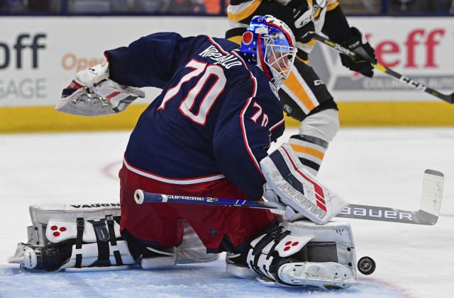 Columbus Blue Jackets goalie Joonas Korpisalo makes a save during the third period of a preseason NHL hockey game against the Pittsburgh Penguins, Saturday, Sept. 21, 2019, in Columbus, Ohio. The Blue Jackets won 3-1. (AP Photo/David Dermer)