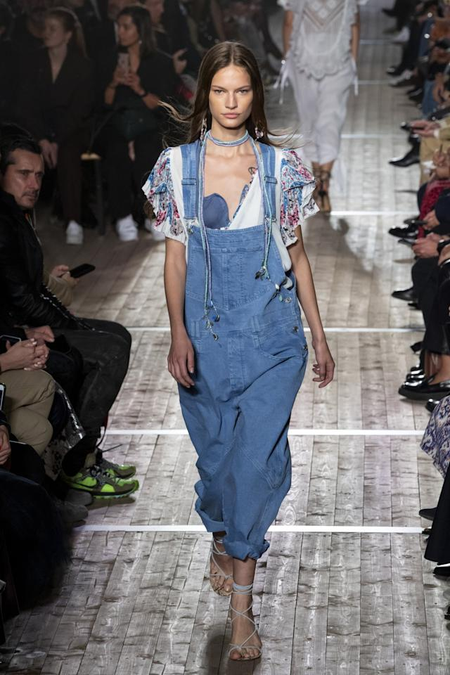 <p>Isabel Marant kept it low-key with overalls, layering everything from bohemian-inspired blouses to colorful jewelry on heavy.</p>