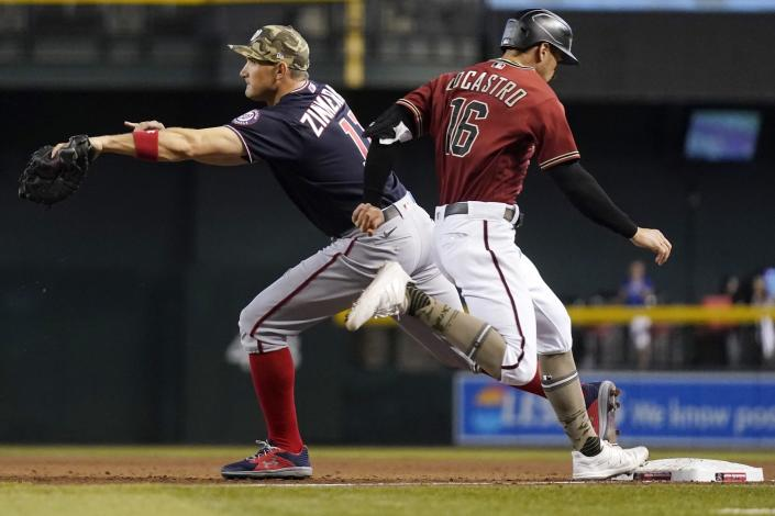 Washington Nationals first baseman Ryan Zimmerman, left, makes a catch in time to get Arizona Diamondbacks' Tim Locastro, right, out at first base during the second inning of a baseball game Sunday, May 16, 2021, in Phoenix. (AP Photo/Ross D. Franklin)
