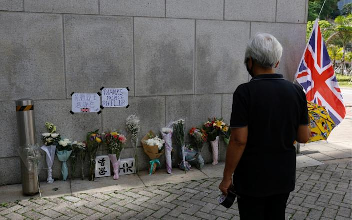 Flowers lie outside the British Consulate-General, Hong Kong, after Britain's Prince Philip, husband of Queen Elizabeth, died at the age of 99 - Tyrone Siu/Reuters