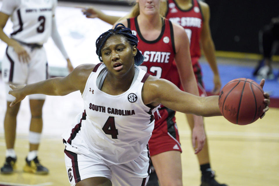 South Carolina forward Aliyah Boston (4) attempts to save the ball during the second half of the team's NCAA college basketball game against North Carolina State on Thursday, Dec. 3, 2020, in Columbia, S.C. (AP Photo/Sean Rayford)