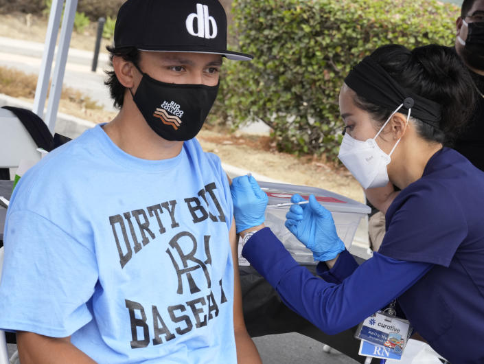Nurse Anita Huang gives the Pfizer vaccine to Justin Mataalii during a vaccination clinic at Rio Hondo College in Whittier, Calif. (Keith Birmingham/MediaNews Group/Pasadena Star-News via Getty Images)