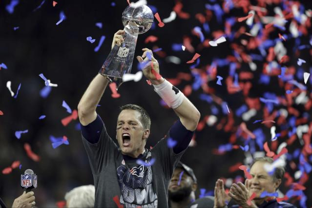 New England Patriots' Tom Brady raises the Vince Lombardi Trophy after defeating the Atlanta Falcons in overtime at Super Bowl 51. (AP file photo)