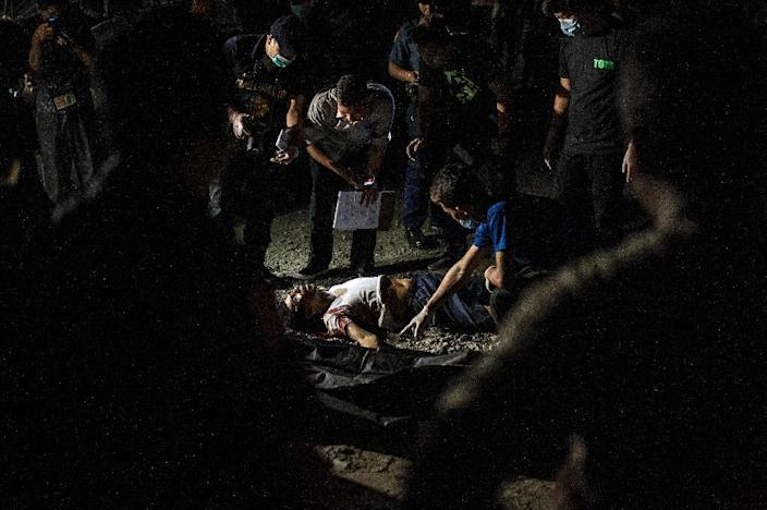 About 800 people have been killed since Rodrigo Duterte won a landslide election in May 2016, according to reports by Philippine local press (AFP Photo/Noel Celis)