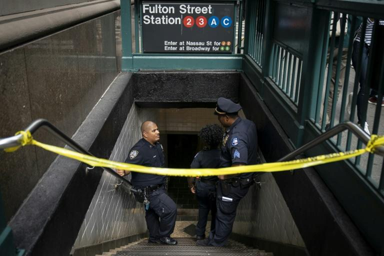 NYPD officers work the scene where there were reports of suspicious packages in the Fulton Street subway station in Lower Manhattan -- the bomb squad determined the objects were rice cookers and did not contain explosives