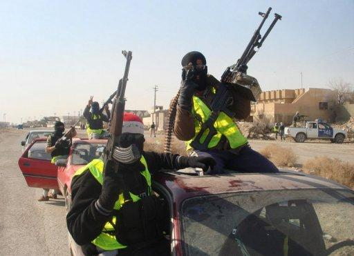 "Armed Sahwa or ""Awakening"" militiamen patrol the northern Iraqi city of Samarra, on August 21, 2010"