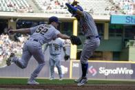 Milwaukee Brewers' Eric Lauer tags out Chicago Cubs' Rafael Ortega after being caught in a rundown during the fifth inning of a baseball game Sunday, Sept. 19, 2021, in Milwaukee. (AP Photo/Morry Gash)