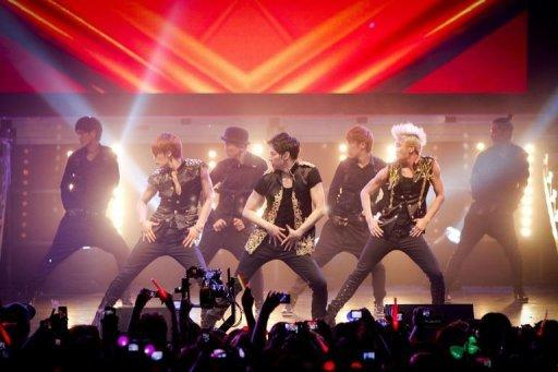 Image provided by C-JeS Entertainment shows South Korean boyband JYJ performing in Santiago, Chile, on March 9. News of the arrival of boyband prompted hundreds of JYJ fans to camp out on the streets recently to get closer to the trio