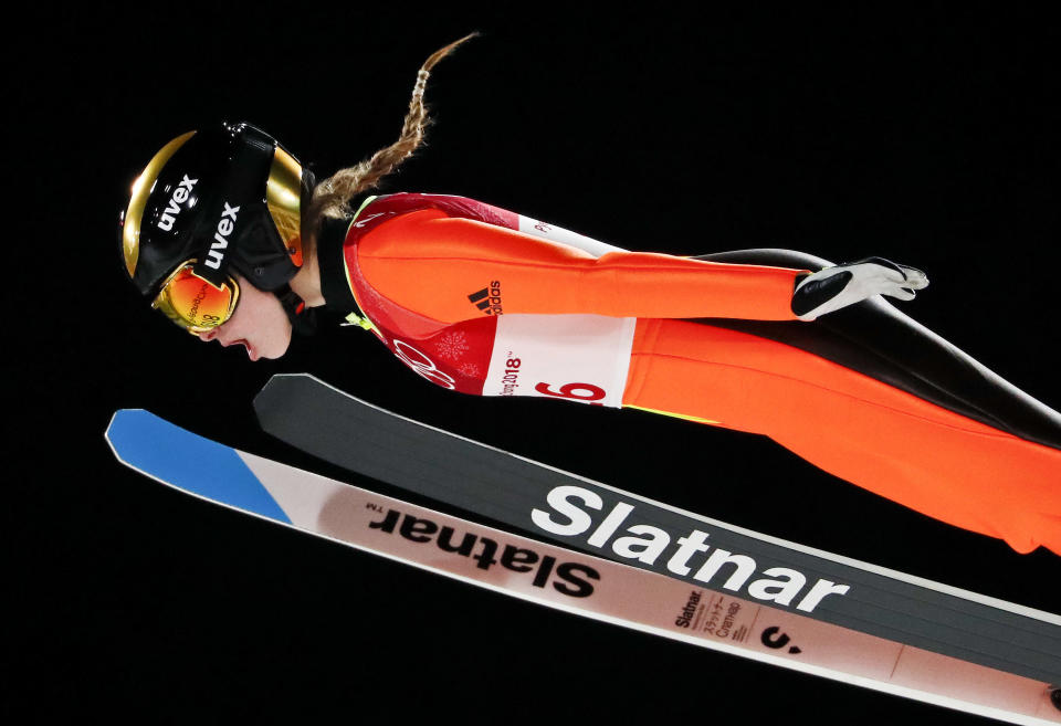 <p>Nika Kriznar, of Slovenia, soars through the air during the women's normal hill individual ski jumping competition at the 2018 Winter Olympics in Pyeongchang, South Korea, Monday, Feb. 12, 2018. (AP Photo/Matthias Schrader) </p>