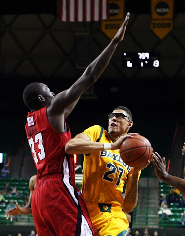 Baylor center Isaiah Austin (21) attempts a shot over Louisiana Lafayette center Vieux Kande (33), left, in the first half of an NCAA college basketball game, Sunday, Nov. 17, 2013, in Waco, Texas. (AP Photo/Waco Tribune Herald, Rod Aydelotte)