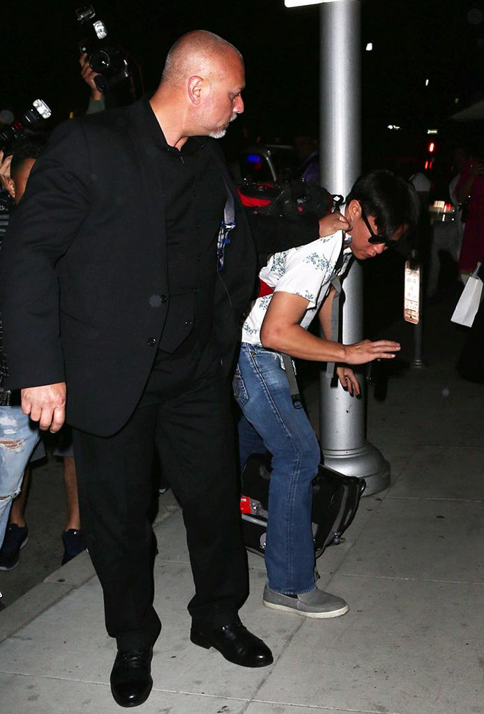 Kim's security swoops in
