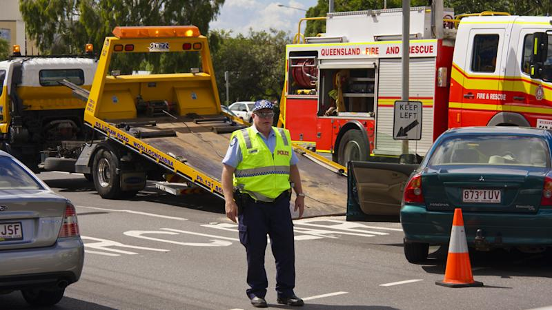 New laws require drivers to slow down when passing emergency vehicles. Pictured is a police officer at the scene of a car accident.