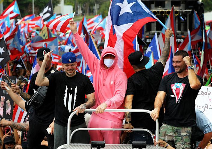 Artists Residente and Bad Bunny join a march a day after Puerto Rico's then-governor, Ricardo Rosselló, announced he would step down after 13 days of protests all across Puerto Rico. (Photo: Pedro Portal/Miami Herald/Tribune News Service via Getty Images)