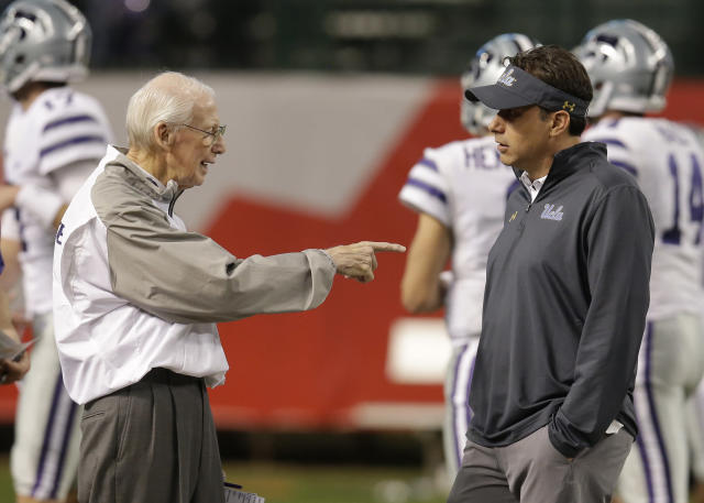 Kansas State head coach Bill Snyder, left, and UCLA head coach Jedd Fisch talk before an NCAA college football bowl game, Tuesday, Dec. 26, 2017, in Phoenix. (AP Photo/Rick Scuteri)