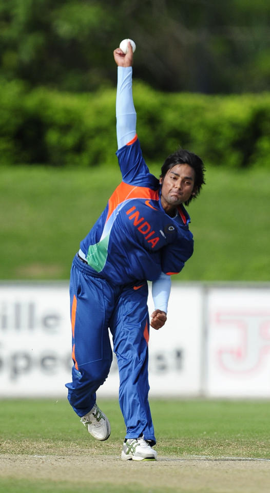 TOWNSVILLE, AUSTRALIA - APRIL 15:  Kamal Passi of India bowls during the match between Australia and India on day five of the U19 International Quad Series at Tony Ireland Stadium on April 15, 2012 in Townsville, Australia.  (Photo by Ian Hitchcock/Getty Images)
