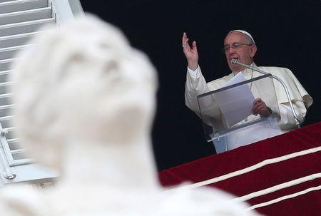 Pope Francis blesses the faithful during his Sunday Angelus prayer on the feast of the Assumption, the day Catholics celebrate Mary's rise into heaven, in Vatican