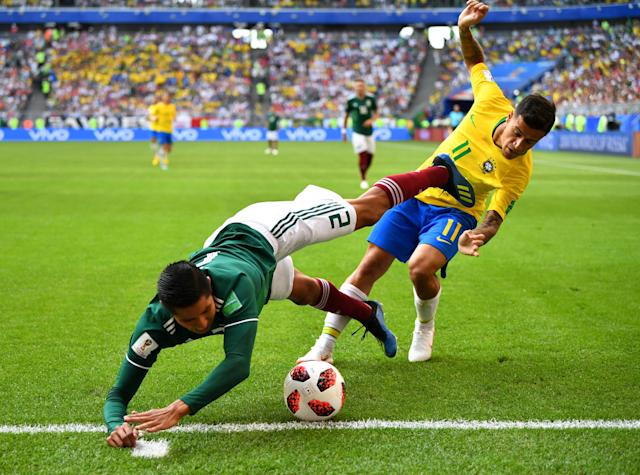 <p>Mexico's Hugo Ayala in action with Brazil's Philippe Coutinho REUTERS/Dylan Martinez </p>