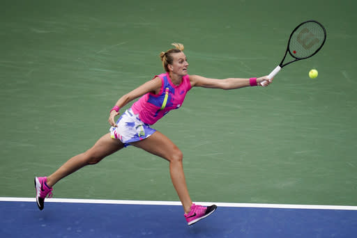 Petra Kvitova, of the Czech Republic, returns a shot to Shelby Rogers, of the United States, during the fourth round of the US Open tennis championships, Sunday, Sept. 6, 2020, in New York. (AP Photo/Seth Wenig)
