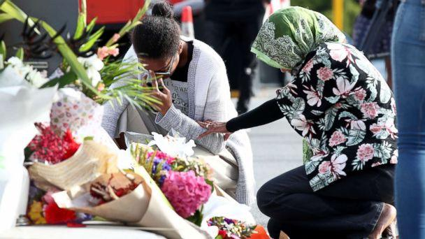 PHOTO: Locals lay flowers in tribute to those killed and injured at Deans Avenue near the Al Noor Mosque, March 16, 2019, in Christchurch, New Zealand. (Fiona Goodall/Getty Images)