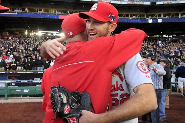 St. Louis Cardinals pitcher Michael Wacha, right, celebrates with teammates after a 2-1 win over the Pittsburgh Pirates in Game 4 of a National League baseball division series, Monday, Oct. 7, 2013, in Pittsburgh. (AP Photo/Gene J. Puskar)