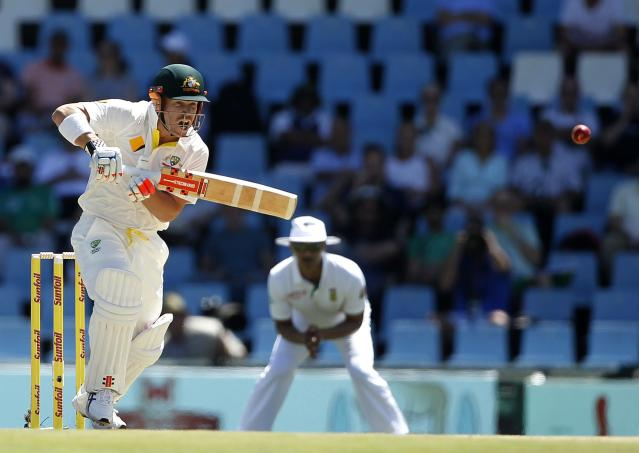 Australia's David Warner plays a shot during the first day of their cricket test match against South Africa in Centurion February 12, 2014. REUTERS/Siphiwe Sibeko (SOUTH AFRICA - Tags: SPORT CRICKET)
