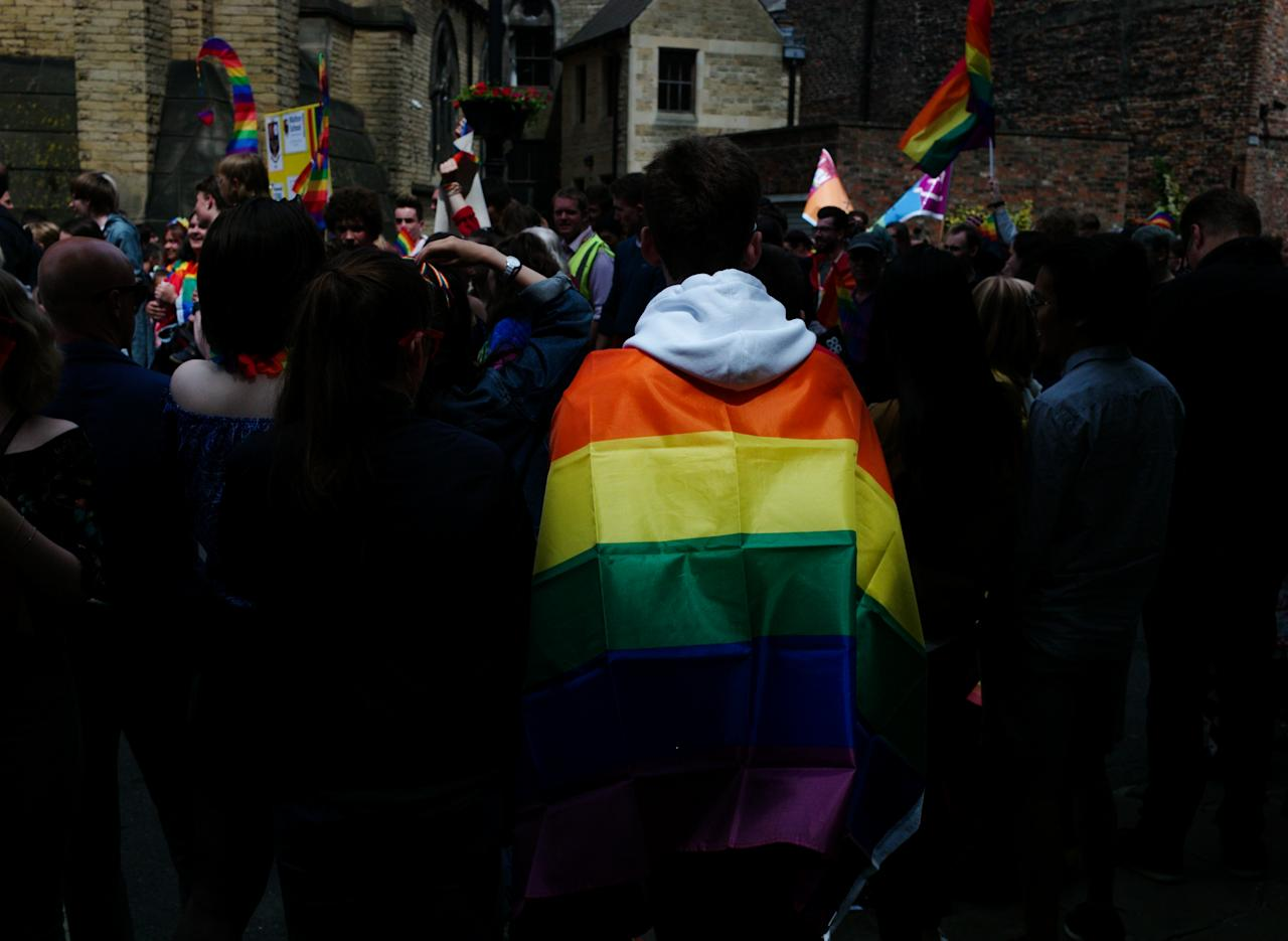 <p>People attend the York Pride parade on June 9, 2018 in York, England. The parade made its way through the streets of the city center before reaching the Knavesmire area of the city where live music entertained the crowds. York Pride aims to raise awareness of lesbian, gay, bisexual and transgender (LGBT) issues both in the UK and abroad and seeks to promote equality and eliminate discrimination on the grounds of sexual orientation and gender identity. (Photo: Ian Forsyth/Getty Images) </p>