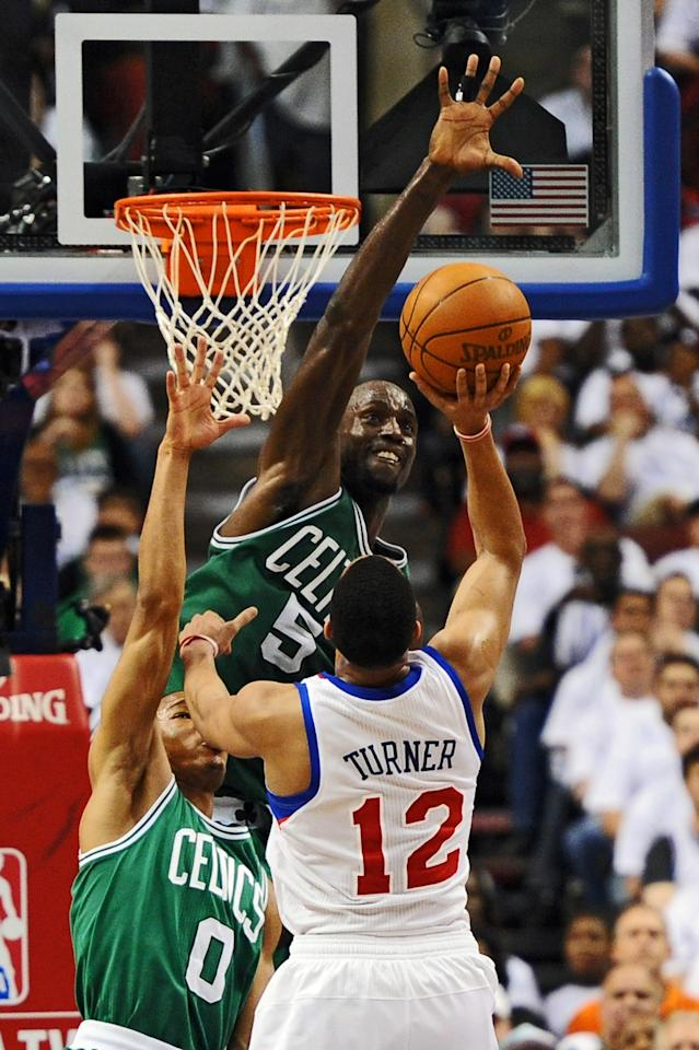 PHILADELPHIA, PA - MAY 18: Avery Bradley #0 and Kevin Garnett #5 of the Boston Celtics try to block a shot by Evan Turner #12 of the Philadelphia 76ers in Game Four of the Eastern Conference Semifinals in the 2012 NBA Playoffs at the Wells Fargo Center on May 18, 2012 in Philadelphia, Pennsylvania. NOTE TO USER: User expressly acknowledges and agrees that, by downloading and or using this photograph, User is consenting to the terms and conditions of the Getty Images License Agreement. (Photo by Drew Hallowell/Getty Images)