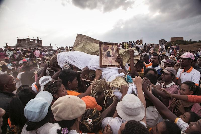 A plague outbreak sweeping Madagascar has prompted warnings that the ritual, known as the turning of the bones, presents a contamination risk (AFP Photo/RIJASOLO)