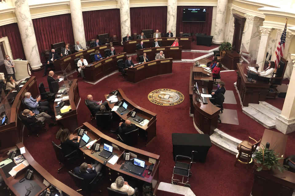 FILE - In this Aug. 26, 2020, file photo, the Idaho Senate debates a bill, at the Statehouse in Boise, Idaho. As states brace for a coronavirus surge following holiday gatherings, one place stands out as a potential super-spreader site, the statehouses where lawmakers will help shape the response to the pandemic. (AP Photo/Keith Ridler, File)