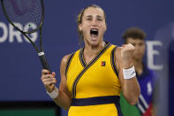 Aryna Sabalenka, of Belarus, reacts after defeating Elise Mertens, of Belgium, during the fourth round of the US Open tennis championships, Sunday, Sept. 5, 2021, in New York. (AP Photo/John Minchillo)