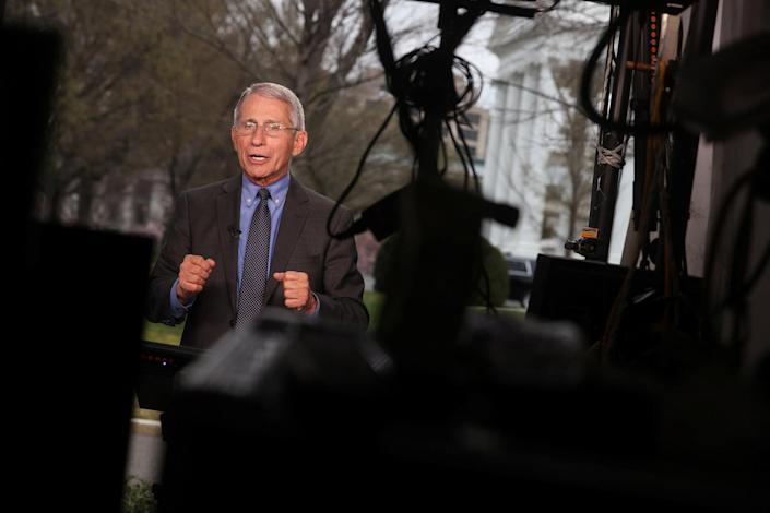 Image: NIH National Institute of Allergy and Infectious Diseases Director Anthony Fauci gives television interviews about the Trump administration's response to the coronavirus outbreak at the White House (Jonathan Ernst / Reuters)