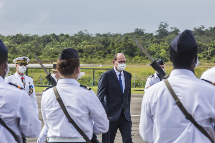 France's Prime Minister Jean Castex arrives at the Matoury Air Base 367, near Cayenne, French Guiana, Sunday, July 12, 2020. As virus numbers soar in French Guiana, France's new prime minister traveled Sunday to the South American territory and promised not to ignore its suffering. (AP Photo/Pierre-Olivier Jay)