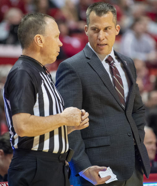 Troy coach Scott Cross talks with an official during the team's NCAA college basketball game against Indiana on Saturday, Nov. 16, 2019, in Bloomington, Ind. (Rich Janzaruk/The Herald-Times via AP