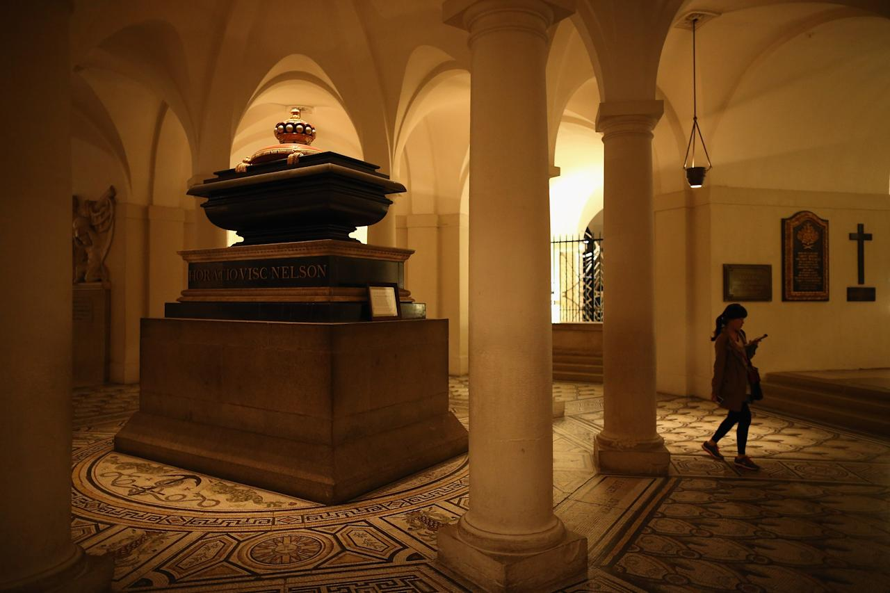 LONDON, ENGLAND - APRIL 15:  A visitor walks past Admiral Lord Nelson's tomb, in the Crypt in St Paul's Cathedral ahead of the funeral of former British Prime Minister Margaret Thatcher on April 15, 2013 in London, England. On Wednesday April 17, over 2,000 guests including global political figures and celebrities will attend the funeral of Margaret Thatcher at St Paul's Cathedral. The service will include 700 serving Armed Forces personnel, and will be led by the Band of the Royal Marines. The 87 year-old former prime minister died after suffering a stroke on April 8.  (Photo by Dan Kitwood/Getty Images)
