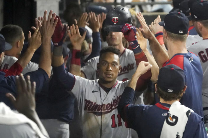 Minnesota Twins' Jorge Polanco (11) celebrates in the dugout his three-run home run off Chicago White Sox relief pitcher Codi Heuer during the sixth inning of a baseball game Wednesday, July 21, 2021, in Chicago. (AP Photo/Charles Rex Arbogast)