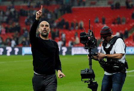"Soccer Football - Premier League - Tottenham Hotspur vs Manchester City - Wembley Stadium, London, Britain - April 14, 2018 Manchester City manager Pep Guardiola celebrates after the match REUTERS/David Klein EDITORIAL USE ONLY. No use with unauthorized audio, video, data, fixture lists, club/league logos or ""live"" services. Online in-match use limited to 75 images, no video emulation. No use in betting, games or single club/league/player publications. Please contact your account representative for further details. - RC12500EB5E0"