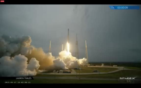 This screenshot from a webcast shows SpaceX's Falcon 9 rocket blasting off on April 27, 2015, carrying the first-ever satellite for the Central Asian nation of Turkmenistan.
