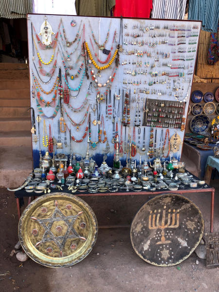 This Jan. 16, 2019, photo shows platters adorned with a menorah and Jewish stars in an outdoor stall near Ksar of Ait-Ben-Haddou in southern Morocco. The North African kingdom once had a thriving Jewish population. Jews of Moroccan descent return often on heritage tours. (Leanne Italie via AP)