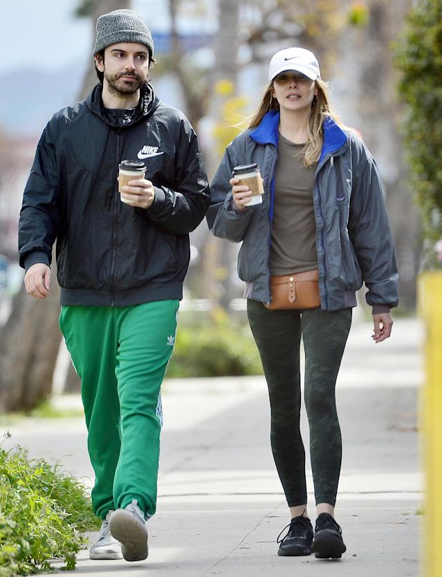<p>Elizabeth Olsen and fiancé Robbie Arnett take a coffee break in L.A. on Saturday.</p>