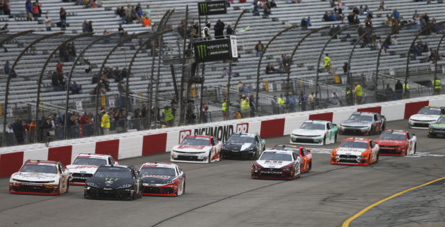 Riley Herbst (18) leads the field at the start of the NASCAR Xfinity Series auto race at Richmond International Raceway in Richmond, Va., Friday, April 12, 2019. (AP Photo/Steve Helber)
