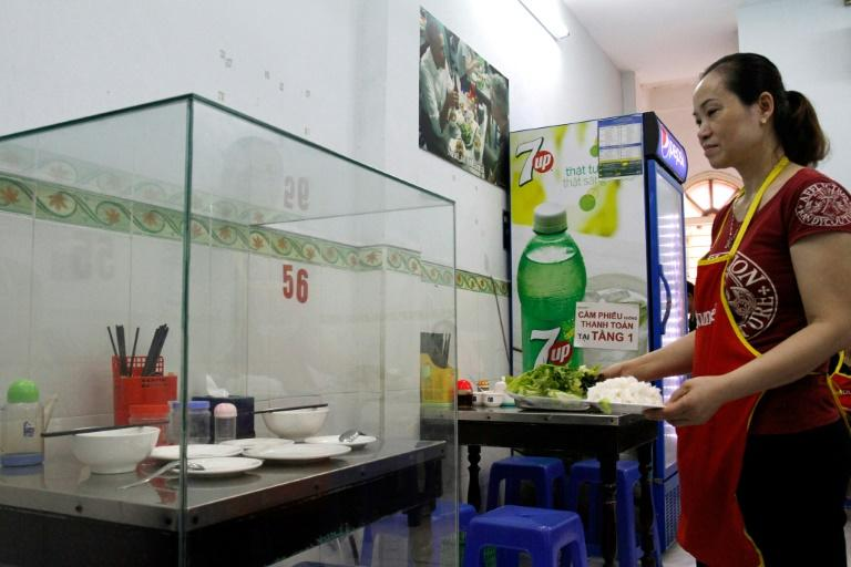 The glass-encased table where former US President Barack Obama sat with chef Anthony Bourdain at Bun Cha Huong Lien restaurant, now dubbed 'bun cha Obama', in Hanoi's Old Quarter