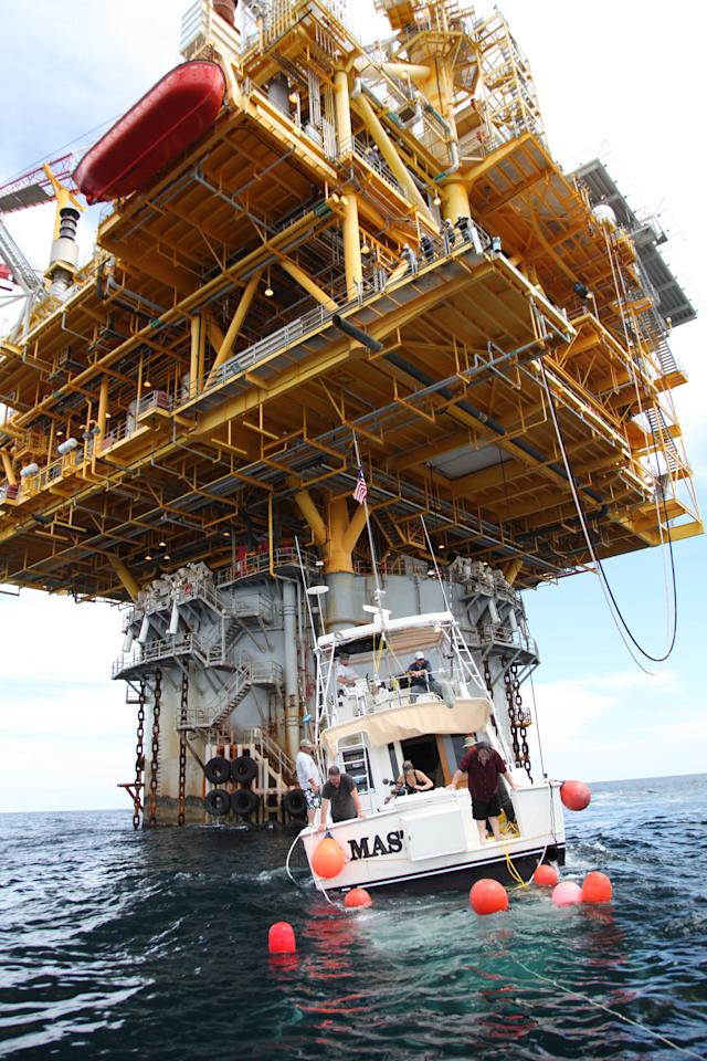 The team explores the waters near an off-shore oil rig.