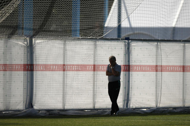 Portugal head coach Fernando Santos walks along the end of the pitch during the training session of Portugal at the 2018 soccer World Cup in Kratovo, outskirts Moscow, Russia, Friday, June 22, 2018. (AP Photo/Francisco Seco)
