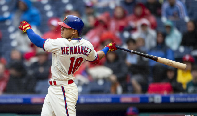 Philadelphia Phillies' Cesar Hernandez (16) follows through on a double during the fourth inning of a baseball game against the Washington Nationals, Sunday, May 5, 2019, in Philadelphia. (AP Photo/Laurence Kesterson)