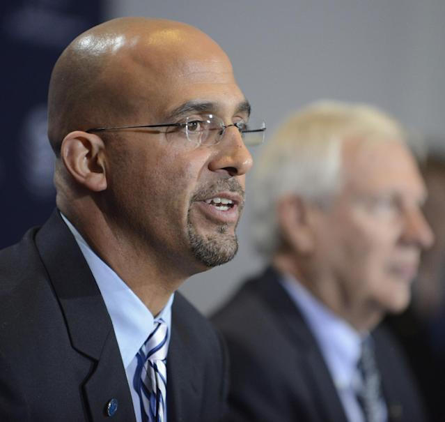 James Franklin, foreground, is introduced as Penn State's new football coach during a news conference on Saturday Jan. 11, 2014, in State College, Pa. Penn State president Rodney Erickson, background, looks on. (AP Photo/ John Beale)