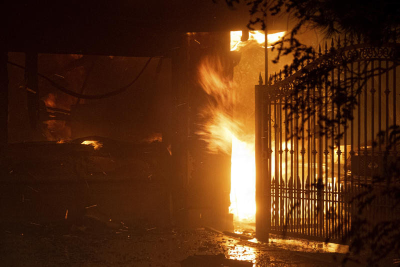 Flames shoot out from the front of a house on Jolette Way in Granada Hills North, Calif., early Friday morning, Oct. 11, 2019. (Photo: David Crane/The Orange County Register via AP)