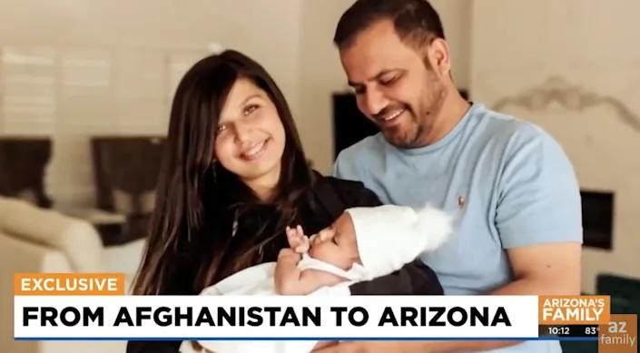 A still from a video of Hameed, Sadia and Liya from an interview with AZ Family. Sadia is holding baby Liya while Hameed smiles next to her.